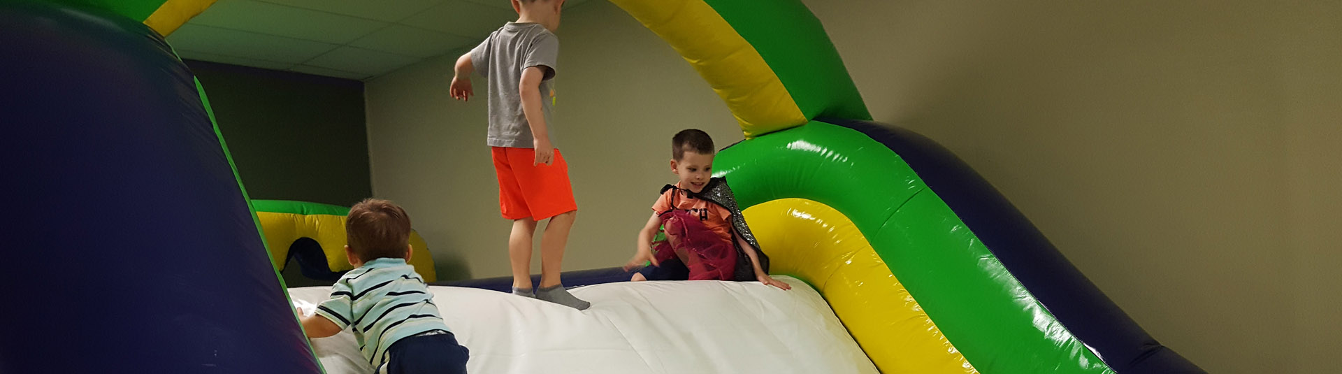 boys playing on indoor bouncy obstacle course | Whiz Kids Play Zone & Party Place - Naples, Florida