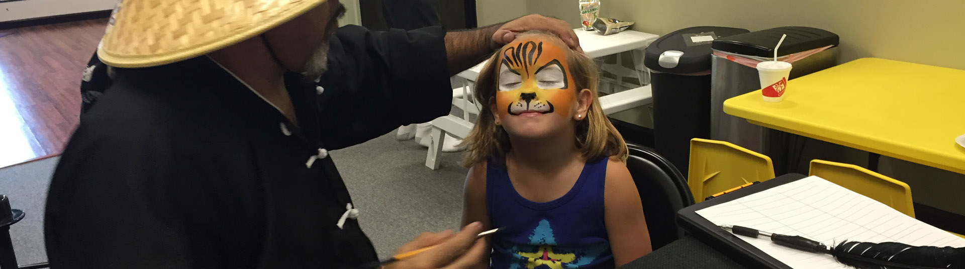 young girl getting her face painted | Whiz Kids Play Zone & Party Place - Naples, Florida