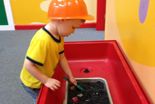 boy playing discovery | Whiz Kids Play Zone & Party Place - Naples, Florida